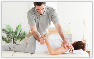 Image of a chiropractor adjusting a patient